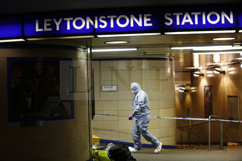 "© Licensed to London News Pictures. 05/12/2015. London, UK. Police officers investigating a crime scene at Leytonstone tube station in east London after a man was seriously injured in a knife attack. The attacker reportedly shouted ""This is for Syria"" during the attack. Photo credit: Tolga Akmen/LNP"