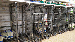 © Licensed to London News Pictures. 03/08/2021. London, UK. Empty trolleys of fresh milk in Sainsbury's, north London. It has been reported that Britain could face a shortage of milk supplies and these are likely to continue for several months, due to a lack of lorry drivers. UK's biggest milk processor, Arla Foods UK, has said that a number of individual stores have missed deliveries due to the pingdemic. Photo credit: Dinendra Haria/LNP