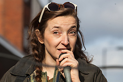 London, UK. 9th February, 2019. Sam Smithson, Vice-Chair of Sustainable Hackney, addresses activists from Extinction Rebellion blocking Kingsland Road in Dalston as part of a 'Saturday street party' intended as a means of engagement around climate change and environmental issues with the local community.