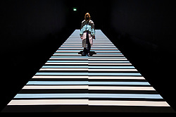 """© Licensed to London News Pictures. 17/05/2021. LONDON, UK. A woman views """"test pattern [no. 12]"""", 2020, by Ryoji Ikeda. Preview of Ryoki Ikeda's exhibition at 180 The Strand, the largest ever European exhibition of the Japanese artist's work.  Twelve audio-visual digital artworks, five of which have never been seen before, are on show 20 May to 1 August 2021.  Photo credit: Stephen Chung/LNP"""