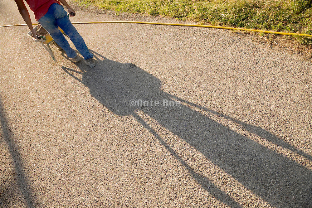 construction worker walking in the early morning with a wheel barrow