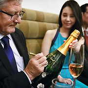 Cellar master Hervé Deschamps of champagne Perrier-Jouët signs a bottle for an escort woman at a market visit in a Japanese nightclub.Founded in 1811 in Epernay, Maison Perrier-Jouët is one of France's most historic champagne houses, but also one of its most distinctive, renowned for its floral and intricate champagnes which reveal the true essence of the Chardonnay grape. Started in 1811, its cellars holds the world's two oldest known bottles of champagne, the 1825 vintage.