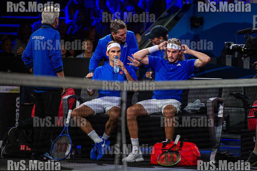 GENEVA, SWITZERLAND - SEPTEMBER 22: Roger Federer of Team Europe and Stefanos Tsitsipas of Team Europe takes a water during Day 3 of the Laver Cup 2019 at Palexpo on September 22, 2019 in Geneva, Switzerland. The Laver Cup will see six players from the rest of the World competing against their counterparts from Europe. Team World is captained by John McEnroe and Team Europe is captained by Bjorn Borg. The tournament runs from September 20-22. (Photo by Monika Majer/RvS.Media)