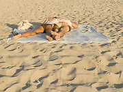 young couple sleeping on the beach Miami USA
