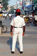 An Indian policeman directing traffic wearing the French style uniform and Kepi hat, Pondicherry, India. Pondicherry now Puducherry is a Union Territory of India and was a French territory until 1954 legally on 16 August 1962. .