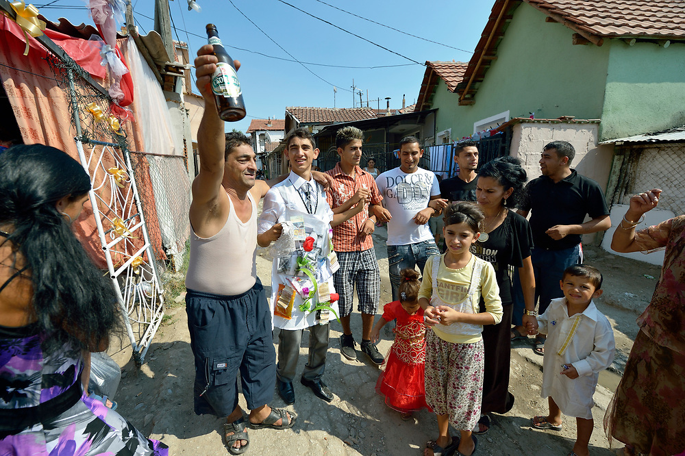 The groom's father toasts his son and his new wife during a wedding in Suto Orizari, Macedonia. The mostly Roma community, located just outside Skopje, is considered Europe's largest Roma settlement. .