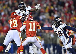 October 30, 2017 - Kansas City, MO, USA - Kansas City Chiefs quarterback Alex Smith avoids the sack by Denver Broncos outside linebacker Von Miller and runs for a first down in the second quarter during Monday's football game on Oct. 30, 2017 at Arrowhead Stadium in Kansas City, Mo. (Credit Image: © John Sleezer/TNS via ZUMA Wire)