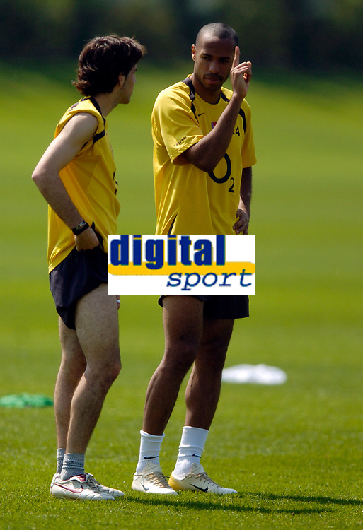 Photo: Richard Lane.<br />Arsenal Training Session. The Barclays Premiership. 11/05/2006.<br />Francesc Fabregas (L) and Thierry Henry talk tactics in training.