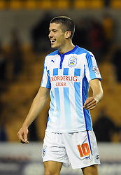 Huddersfield Town's goalscorer, Conor Coady smiles as his side go on to win 1 - 3 - Photo mandatory by-line: Dougie Allward/JMP - Mobile: 07966 386802 - 01/10/2014 - SPORT - Football - Wolverhampton - Molineux Stadium - Wolverhampton Wonderers v Huddersfield Town - Sky Bet Championship