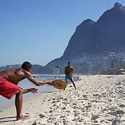 Locals play beach tennis at Sao Conrado beach, Rio de Janeiro,  Brazil. 8th July 2010. Photo Tim Clayton..