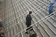 a white collar worker walking up some stairs