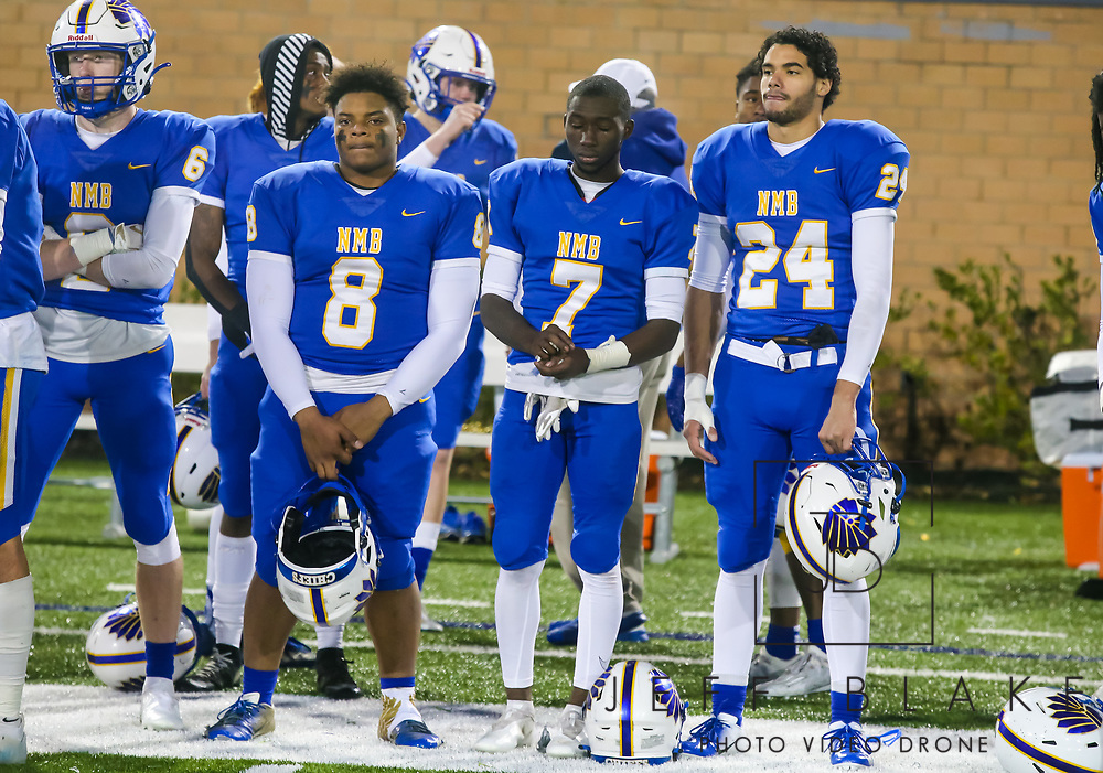 North Myrtle Beach Chiefs Devin Montgomery (8), North Myrtle Beach Chiefs Nyliek Livingston (7), and North Myrtle Beach Chiefs Tyree Smith (24) watch AC Flora Falcons celebrate beating them in the state championship game at Benedict College.