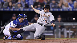 September 27, 2017 - Kansas City, MO, USA - The Detroit Tigers' Alex Presley (14) scores as the throw to Kansas City Royals catcher Drew Butera is late in the third inning at Kauffman Stadium in Kansas City, Mo., on Wednesday, Sept. 27, 2017. (Credit Image: © John Sleezer/TNS via ZUMA Wire)
