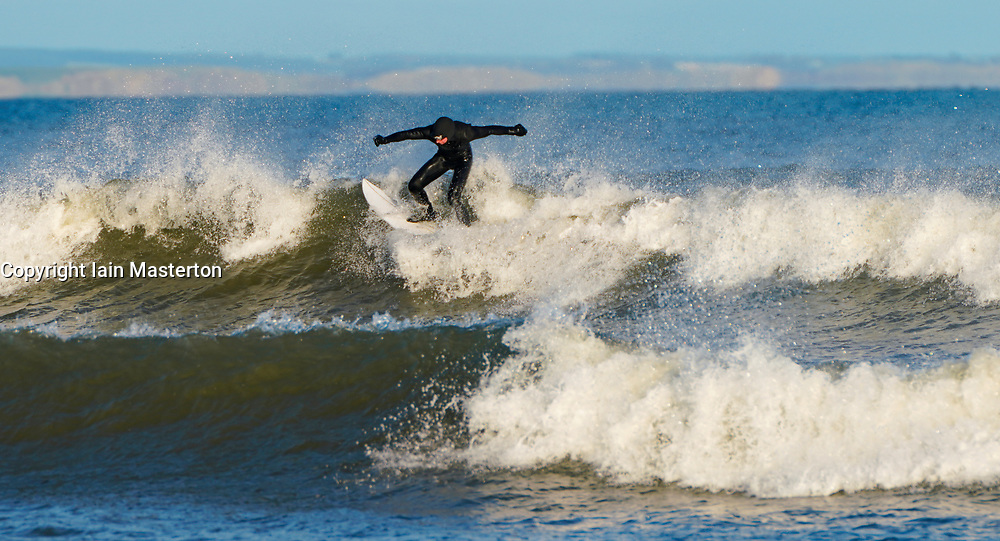Aberdeen, Scotland, UK. 1st December 2019. Surfers took advantage of bright sunshine and favourable winds creating good waves along the beach at Aberdeen. Iain Masterton/Alamy Live News.