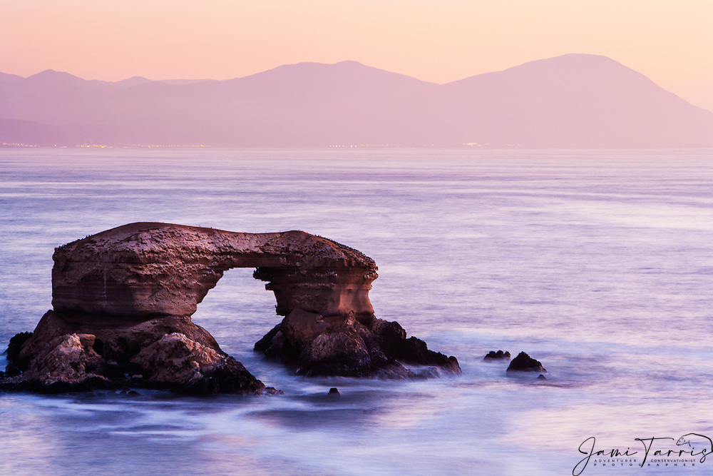 La Portada, a natural arch on a volcanic base, is located off the coast of Chile near Antofagasta, Chile, South America