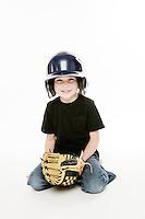 Tucker Ward 5 year old boy playing catch with baseball mitt, helmet  in the studio.