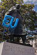 """As thousands of British voters march through London to protest against the referendum decision to leave the EU (Brexit), EU balloons are attached to the statue of Sir Winston Churchill, on 2nd July 2016, in London UK. Demonstrators at the """"March for Europe"""" rally, which was organised on social media walked from Park Lane into the heart of the UK government in Westminster to send a message of dissatisfaction in the referendum result. More than 46.5 million people voted in the referendum on 23 June, which resulted in the UK voting by 51.9% to 49.1% to withdraw from the EU."""