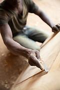 Close-up of man working in Musoto Carpentry Workshop in Musoto, Musoto, Uganda
