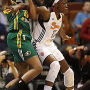 Chiney Ogwumike, (right), Connecticut Sun, is defended by Camille Little, Seattle Storm, during the Connecticut Sun Vs Seattle Storm WNBA regular season game at Mohegan Sun Arena, Uncasville, Connecticut, USA. 23rd May 2014. Photo Tim Clayton