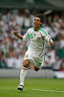 Fotball<br /> Foto: Piko Press/Digitalsport<br /> NORWAY ONLY<br /> <br /> MEXICO vs. JAMAICA in their World Cup 2010 qualifying soccer match in Mexico D.F., September 6, 2008<br /> Here Mexican player Fernando Arce celebrating his goal.