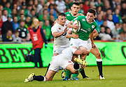 Ireland wing Hugo Keenan is held in a tackle during the World Rugby U20 Championship Final   match England U20 -V- Ireland U20 at The AJ Bell Stadium, Salford, Greater Manchester, England onSaturday, June 25, 2016. (Steve Flynn/Image of Sport)