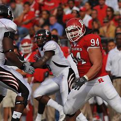 Sep 7, 2009; Piscataway, NJ, USA; Rutgers defensive tackle Scott Vallone (94) battles Cincinnati offensive lineman Sam Griffin (66) during the first half of Rutgers 47-15 loss to Cincinnati in NCAA college football at Rutgers Stadium.
