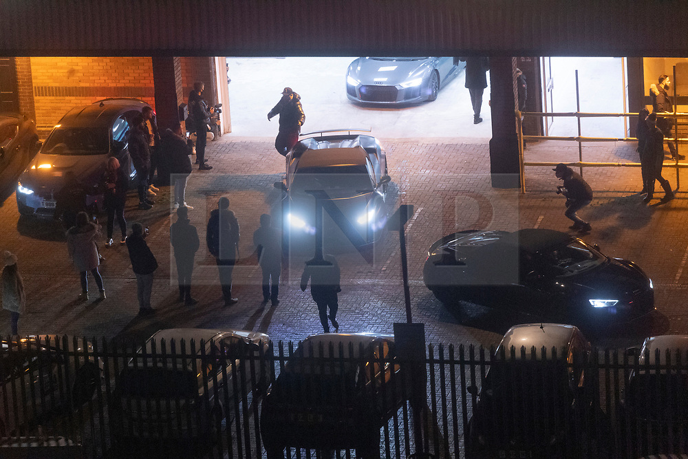 © Licensed to London News Pictures. 27/11/2020. London, UK. Car enthusiasts taking part in a sports car rally meeting leave an an industrial estate in Alperton, North-West London during the second Covid-19 lockdown.  Police officers arrived and disbursed the drivers. Photo credit: London News Pictures