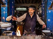 06 MARCH 2017 - KATHMANDU, NEPAL: A chapati maker in a Kathmandu tea house. Chapati is a type of flatbread popular in south Asia.      PHOTO BY JACK KURTZ