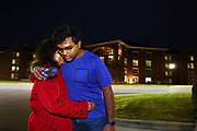 Mayukh Datta hugs his mother goodbye as he returns to college at Mississippi State in Starkville, Mississippi after Christmas break. Mayukh will soon be aging out of dependency, which could affect his Visa status. Photo by Karen Pulfer Focht