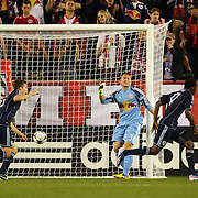 Aurélien Collin, Sporting Kansas City, (out of picture), scores the only goal of the match beating New York Red Bulls keeper Luis Robles at the near post during the New York Red Bulls V Sporting Kansas City, Major League Soccer regular season match at Red Bull Arena, Harrison, New Jersey. USA. 17th April 2013. Photo Tim Clayton