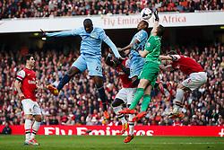 Man City Midfielder Yaya Toure (CIV) and Midfielder Fernandinho (BRA) jump up for a corner as Arsenal Goalkeeper Wojciech Szczesny (POL) tips the ball clear - Photo mandatory by-line: Rogan Thomson/JMP - 07966 386802 - 29/03/14 - SPORT - FOOTBALL - Emirates Stadium, London - Arsenal v Manchester City - Barclays Premier League.
