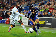 Cardiff City's Fabio Da Silva (r) takes on Hull's Sone Aluko. Skybet football league championship match, Cardiff city v Hull city at the Cardiff city stadium in Cardiff, South Wales on Tuesday 15th Sept 2015.<br /> pic by Carl Robertson, Andrew Orchard sports photography.