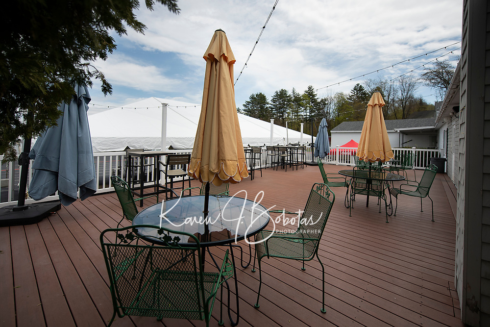Hart's Turkey Farm's outdoor seating will offer their deck plus a large tent to accommodate patrons keeping with the social distancing guidelines to begin on Monday.   (Karen Bobotas/for the Laconia Daily Sun)
