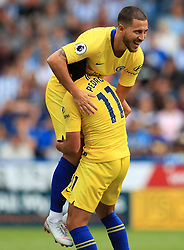 Chelsea's Pedro (bottom) celebrates scoring his side's third goal of the game with team-mate Eden Hazard during the Premier League match at the John Smith's Stadium, Huddersfield.