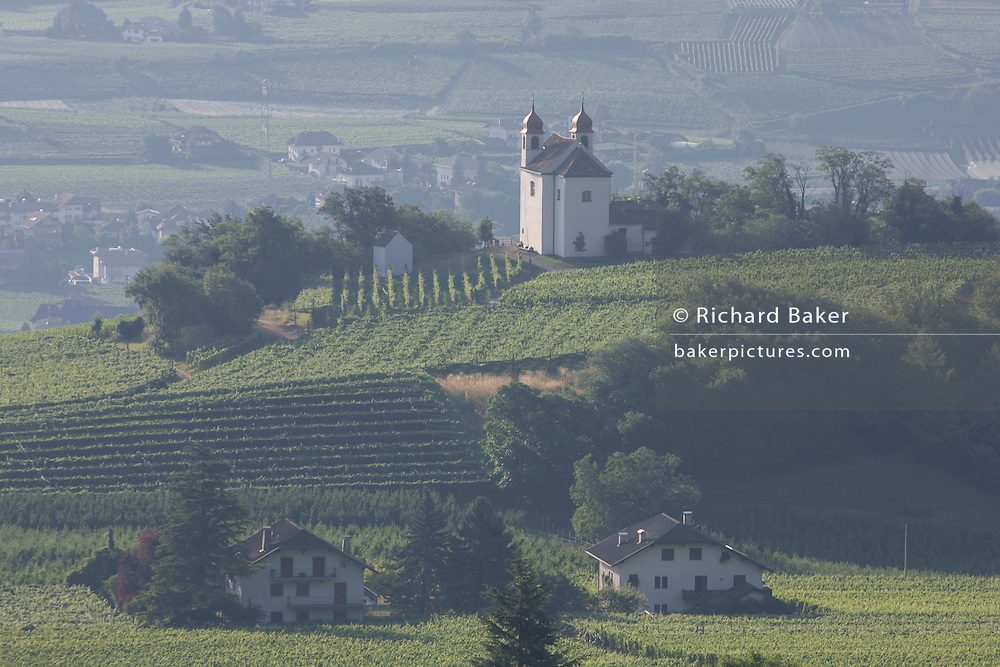 Local chapel on hillside overlooking wine-growing valley south-west of Bolzano, South Tyrol, northern Italy.