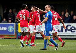 Charlton Athletic's Karlan Ahearne-Grant (centre) celebrates his goal with team mates during the Emirates FA Cup 2nd Round match at Kingsmeadow London