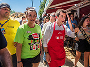 13 AUGUST 2019 - DES MOINES, IOWA: PETE BUTTIGIEG wipes his brow after flipping pork chops at the Iowa State Fair. Buttigieg, the Mayor of South Bend, Indiana, is running to be the Democratic nominee for the US presidency. He spoke at the Des Moines Register Political Soap Box at the Iowa State Fair and then toured the fairgrounds. Iowa has the first event of the presidential selection cycle. The Iowa Caucuses are February 3, 2020.              PHOTO BY JACK KURTZ