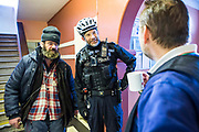 The local police officer visiting Slough Homeless our concern (SHOC) A local homeless charity helping the homeless and vulnerable in Slough. Berkshire, UK.
