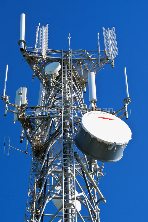 Cellular, microwave and communications antenna array for the mobile telephone system on a tower. <br /> <br /> Editions:- Open Edition Print / Stock Image