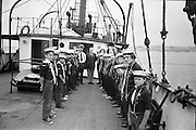 """Sea Scouts aboard the Lightship """"Albatross""""..1972..22.07.1972..07.22.1972..22nd July 1972..Standing at the head of the line, Mr Brendan O'Kelly,Chief Executive,BIM, poses with the assembled sea scouts."""