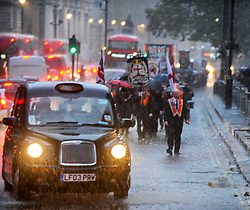 Orange men of the Orange order march along Whitehall to lay wreaths at the Cenotaph London, 10 November 2018.