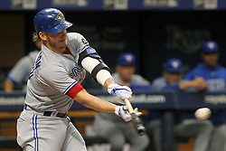 May 6, 2018 - St. Petersburg, FL, U.S. - ST. PETERSBURG, FL - MAY 06: Josh Donaldson (20) of the Blue Jays hits a line drive during the MLB regular season game between the Toronto Blue Jays and the Tampa Bay Rays on May 06, 2018, at Tropicana Field in St. Petersburg, FL. (Photo by Cliff Welch/Icon Sportswire) (Credit Image: © Cliff Welch/Icon SMI via ZUMA Press)