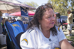 August 26, 2017 - Los Angeles, CA, United States - Charger fan Karen Fast of Bellflower was surrounded by Rams fans before the start of the game but is glad to have the Chargers playing closer to her home. (Credit Image: © David Crane/The Orange County Register via ZUMA Wire)