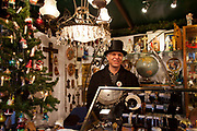 Market trader on his stall, Alter Markt / Old Market in front of the town hall in Cologne.