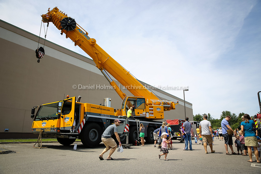 (6/13/15, MARLBOROUGH, MA) An enormous crane was on display during the Touch-A-Truck event at the Solomon Pond Mall in Marlborough on Saturday. Daily News and Wicked Local Photo/Dan Holmes