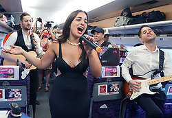 August 26, 2017 - Shanghai, China - An Italian singer performs in the 'romance train'. Shanghai Railway Bureau launches the Romance Train D2216 on Saturday for the first time to greet the Qixi festival, or Chinese Valentine's Day. (Credit Image: © Chen Fei/Xinhua via ZUMA Wire)
