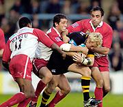 2004/05 Heineken Cup - London Wasps v Biarritz <br /> 24.10.2004.<br /> Wasps Peter Richards's attack is halted. <br /> ,