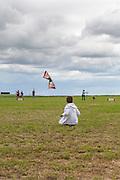 Spencer Watson and his stunt kite. Windscape Kite Festival, Swift Current, Saskatchewan.