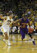December 07 2010: Northern Iowa Panthers guard Kwadzo Ahelegbe (11) drives around Iowa Hawkeyes guard Eric May (25) during the first half of their NCAA basketball game at Carver-Hawkeye Arena in Iowa City, Iowa on December 7, 2010. Iowa defeated Northern Iowa 51-39.