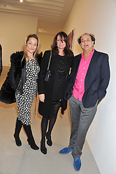 Left to right, TARA AGACE, TRISH SIMONON and GERRY FOX at a private view of work by Mat Collishaw - 'This is Not an Exit' held at Blaine/Southern, 4 Hanover Square, London on 13th February 2013.